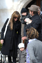 Angelina donned a long black scarf with her wool coat while in Venice with the family.