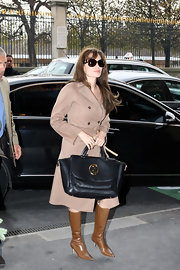 Angelina Jolie was as sophisticated as ever carrying the Gucci 1973 satchel. The black leather tote was the perfect classic look for the actress.