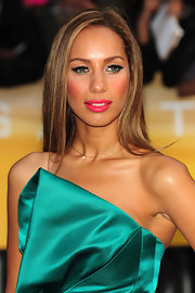 Leona Lewis paired her satin green dress with sleek straight locks.