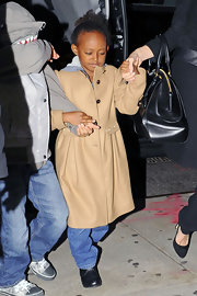 Zahara Jolie-Pitt looked cute as a button in this khaki colored A-line pea coat.