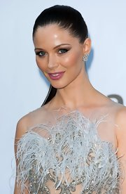 Georgina Chapman swept on smoky shades of shadow to complement her glittering dove gray gown.