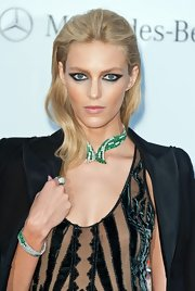 Since there was so much going on with her look, Anja Rubik opted keep her hairstyle slicked-back and simple.