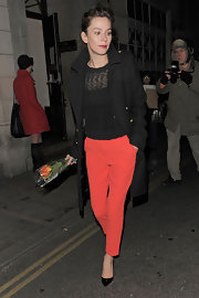 Anna Friel brightened up her winter wardrobe with a pair of red hot slacks.