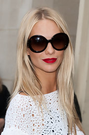 Poppy Delevigne attended the Chanel fall 2012 runway show wearing a matte blue-based red lipstick.