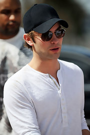 Chace wore a basic baseball cap at the Beach Bowl event in Miami.