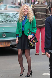 A Kelly-green officer's coat gave Annasophia's ladylike look little a bit of uptown posh.