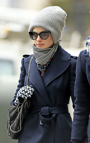 Anne Hathaway bundled up in a cool patterned scarf while walking through NYC.