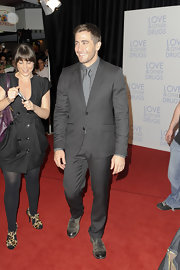 Jake looks seriously handsome in a charcoal gray suit.
