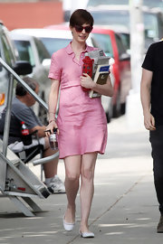 Anne Hathaway sported a casual but flirty pink shirtdress while on set in NYC.
