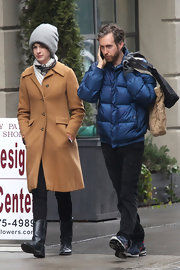 Anne Hathaway chose a classic wool coat in a cool camel color for her daytime look while out with her husband.