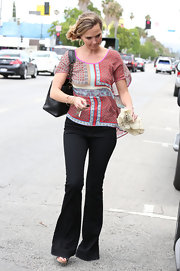 Arielle Kebbel kept her look hippie-inspired from head to toe with a pair of flare jeans.