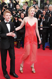 Christa Theret jumped in on the Art Deco trend with this elegant red dress for the Cannes Film Festival.