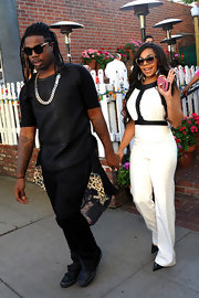 Ashanti chose a black and white look with this sleeveless white jumpsuit with black trim.