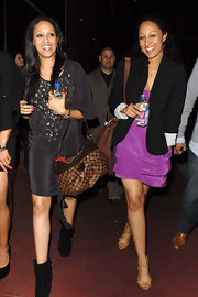 Actress Tia Mowry made her way out of the Jay-Z concert toting a printed shoulder bag while walking with twin sister Tamera.