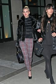 Ashlee Simpson made her evening look pop with tartan-print skinny pants.