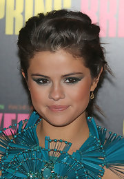 Selena Gomez's dark brown eyes popped with a green smoky eye with slight cat eye flare at the 'Spring Breakers' premiere.