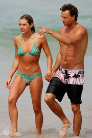 Ashley Hart was spotted having fun at the beach wearing a green halter bikini.