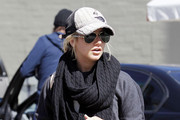 Actress Ashley Tisdale maintains a low profile as she stops for gas after grabbing lunch with a friend in Studio City.  Photograph.