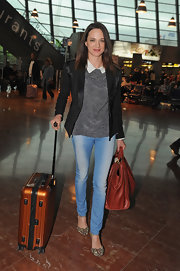 Asia Argento boarded at the Nice Airport wearing jeans, a top, and a black satin-collared blazer.