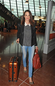 Asia Argento wore a pretty collared print top to the Nice Airport.
