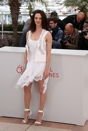 Asia Argento showed up at a movie photocall wearing a lace-trimmed chiffon dress.