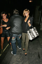 Frankie Sandford added pop to her look with an eye-catching black and white snakeskin tote.