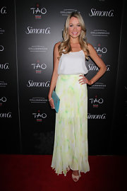 Katrina Bowden's flowing white blouse looked super light and airy when paired with this light green pleated maxi skirt.