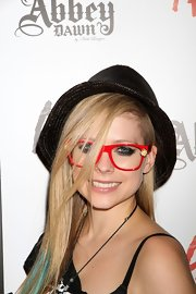 Not only did Avril hide her smoky eyes behind this pair of clear frames, she also played peek-a-boo with her bangs.