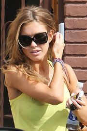 Audrina was spotted in a demur pair of square shades.
