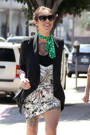 Casey's polka-dot green scarf added some fun color to her outfit.