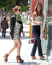 Casey wore a pair of very buckled platform boots whilst out with her sister.