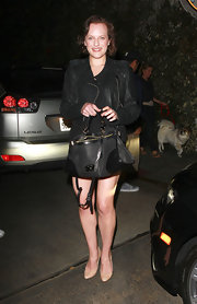 Elisabeth Moss rocked a classic black leather jacket over her LBD in Hollywood.