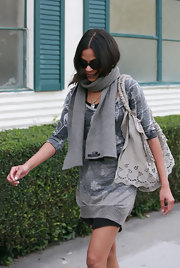 "Zoe carried the adorable ""Laceland Tote"" in gray. The $3,495 handbag featured layered lace and eyelet detailing."