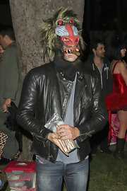 Leonardo DiCaprio was a leather-clad, cigar-smoking baboon during a Halloween party in Beverly Hills.