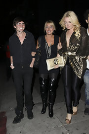 Vienna Girardi is the latest celeb to embrace the over the knee boot trend. Vienna's are super tall, and super shiny!