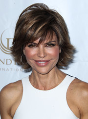 Lisa Rinna added a sense of light-hearted fun with these large hoop earrings.