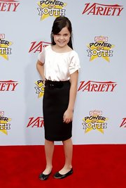 Bailee Madison matched her pencil skirt with white satin blouse.