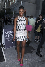 Tika Sumpter cut a svelte silhouette in a black-and-white geometric-print mini dress at the Nicole Miller fashion show.