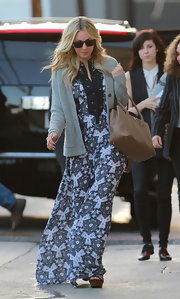 Kaley Cuoco paired a gray cardigan over a printed-maxi for her daytime look.