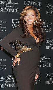 Beyonce accented her brown and gold dress with a large pair of hoop earrings while hosting a screening of 'Live at Roseland.'