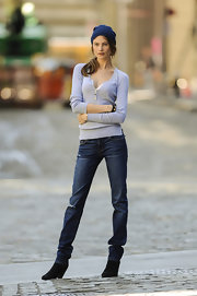 Behait looked casual and cool in gray henley and jeans.