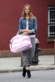 Behati Prinsloo modeled a classic denim jacket while on a photo shoot for Victoria's Secret.