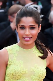 Freida Pinto wore her hair in a simple sleek ponytail for the premiere of 'Rust and Bone.'