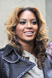 Beyonce attended the unveiling of her cosmetology center in Brooklyn wearing soft metallic silver shadow and rosy pink lipstick.