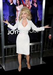 Dolly wore dazzling embellished heels to finish her look.