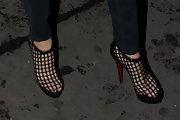 "Blake stepped out in the trendy ""Coussin"" cage ankle boots. The see through heels gave her casual look a trendy finishing touch."