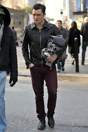 Ed adds these distressed leather boots to his leather jacket and purple denim ensemble.