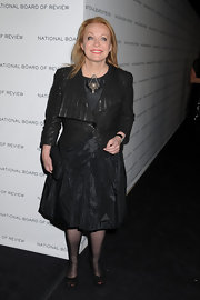 Jacki wears a cropped evening blazer with a single button and a unique texture to the National Board of Review Gala.