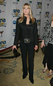 Bo Derek looked cosmopolitan at the 'Night of 100 Stars' party in her all-black pantsuit ensemble.
