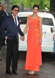 Deepika Padukone visited the ITV studios in a tangerine dress with a strategic side panel.